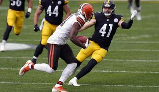 Cleveland Browns wide receiver Donovan Peoples-Jones tries to get past Pittsburgh Steelers linebacker Robert Spillane (41) during an NFL football game, Sunday, Oct. 18, 2020, in Pittsburgh. Spillane carved out a roster spot on the Steelers by becoming a special teams ace. He officially has a new title: the replacement for injured linebacker Devin Bush, who is out for the season after tearing the ACL in his left knee. (AP Photo/Justin Berl)
