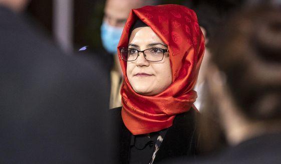 Hatice Cengiz, the fiancee of slain Saudi journalist Jamal Khashoggi, attends the 16th Zurich Film Festival (ZFF) in Zurich, Switzerland, Friday, Oct. 2, 2020. (Alexandra Wey/Keystone via AP)