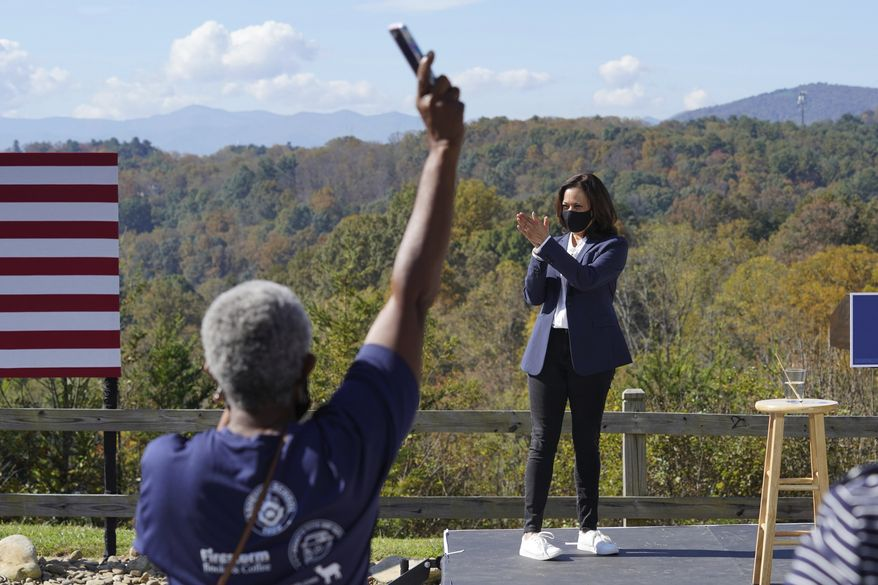 Democratic vice presidential candidate Sen. Kamala Harris, D-Calif., applauds supporters during her appearance at UNC-Asheville, Wednesday, Oct. 21, 2020, in Asheville, N.C. (AP Photo/Kathy Kmonicek)