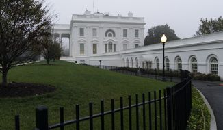 A light fog surrounds the White House, Wednesday, Oct. 21, 2020, in Washington. (AP Photo/Alex Brandon)