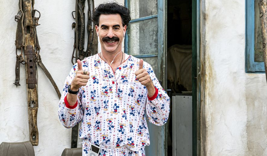 """This image released by Amazon Studios shows Sacha Baron Cohen in a scene from """"Borat Subsequent Moviefilm."""" (Amazon Studios via AP)"""