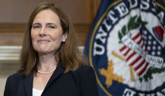 Supreme Court nominee Amy Coney Barrett meets with Sen. James Lankford, R-Okla., Wednesday, Oct. 21, 2020, on Capitol Hill in Washington. (Leigh Vogel/Pool via AP) ** FILE **