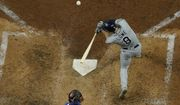 Tampa Bay Rays' Brandon Lowe his a two-run home run off Los Angeles Dodgers starting Dustin May during the fifth inning in Game 2 of the baseball World Series Wednesday, Oct. 21, 2020, in Arlington, Texas. (AP Photo/David J. Phillip)