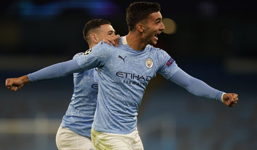 Manchester City's Ferran Torres celebrates after scoring his side's third goal during the Champions League group C soccer match between Manchester City and FC Porto at the Etihad stadium in Manchester, England, Wednesday, Oct. 21, 2020. (Tim Keeton/Pool via AP)