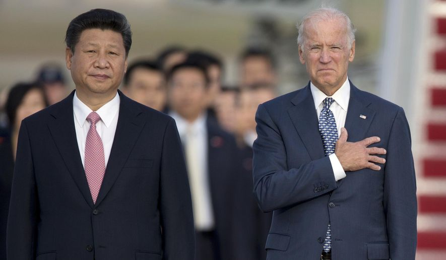 In this Sept. 24, 2015, file photo, Chinese President Xi Jinping, Vice President Joe Biden, stand for the U.S. national anthem during an arrival ceremony in Andrews Air Force Base, Md. (AP Photo/Carolyn Kaster, File)