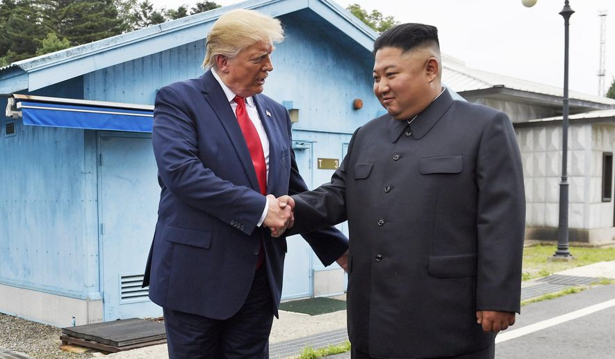 In this June 30, 2019, file photo, President Donald Trump shakes hands with North Korean leader Kim Jong-un at the border village of Panmunjom in the Demilitarized Zone, South Korea. (AP Photo/Susan Walsh, File)