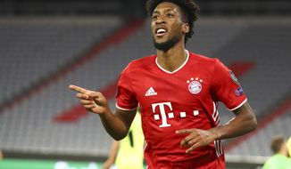 Bayern Munich's Kingsley Coman celebrates after scoring his team's fourth goal during the Champions League Group A soccer match between Bayern Munich and Atletico Madrid at the Allianz Arena in Munich, Germany, Wednesday, Oct. 21, 2020. (AP Photo/Matthias Schrader,Pool)