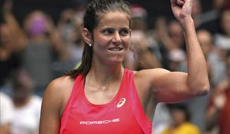 FILE - In this Wednesday, Jan. 22, 2020 file photo, Germany's Julia Goerges celebrates after defeating Croatia's Petra Martic in their second round singles match at the Australian Open tennis championship in Melbourne, Australia. Former Wimbledon semifinalist Julia Goerges announced on Wednesday Oct. 21, 2020, her retirement from tennis at the age of 31. (AP Photo/Lee Jin-man, File)