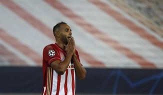 Olympiacos' Youssef El-Arabi, reacts after a missing opportunity to score during the Champions League group C soccer match between Olympiakos and Marseille at Georgios Karaiskakis stadium in Piraeus port, near Athens, Wednesday, Oct. 21, 2020. (AP Photo/Thanassis Stavrakis)