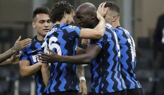 Inter Milan's Romelu Lukaku, second from right, celebrates with his teammates after scoring his side's opening goal during the Champions League group B soccer match between Inter Milan and Borussia Moenchangladbach at the San Siro stadium in Milan, Italy, Wednesday, Oct. 21, 2020. (AP Photo/Luca Bruno)