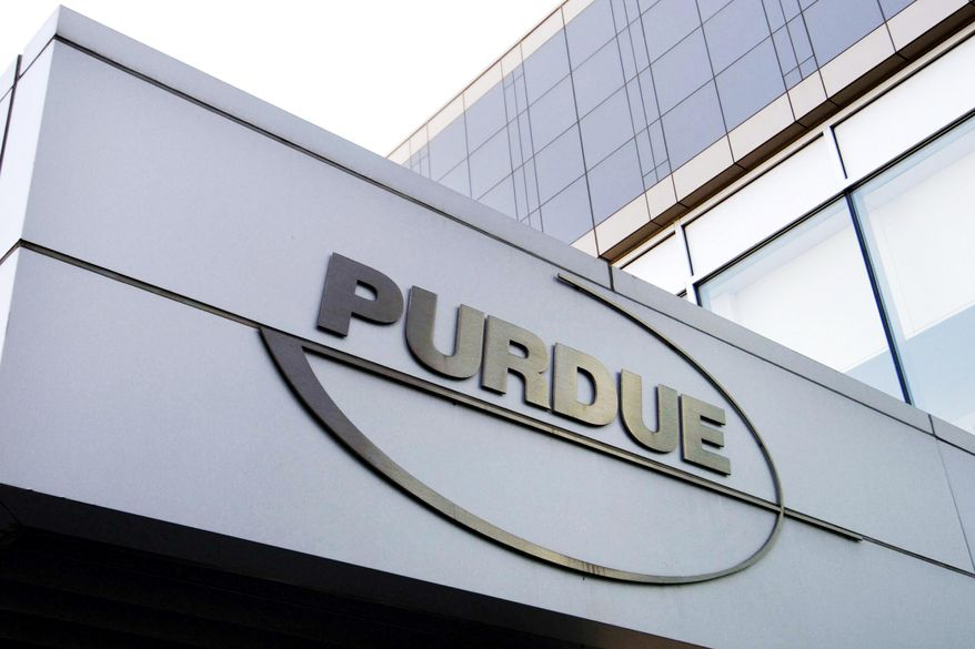 This Tuesday, May 8, 2007, file photo shows the Purdue Pharma logo at its offices in Stamford, Conn. Purdue Pharma, the company that makes OxyContin, the powerful prescription painkiller that experts say helped touch off an opioid epidemic, will plead guilty to three federal criminal charges as part of a settlement of over $8 billion, Justice Department officials told The Associated Press. (AP Photo/Douglas Healey, File)