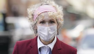 E. Jean Carroll arrives at the Daniel Patrick Moynihan United States Courthouse, Wednesday, Oct. 21, 2020, in New York. Carroll, who says President Donald Trump raped her in the 1990s, was expected to be in court Wednesday to hear lawyers argue whether Trump can substitute the United States for himself as the defendant in her defamation lawsuit. (AP Photo/John Minchillo) ** FILE **