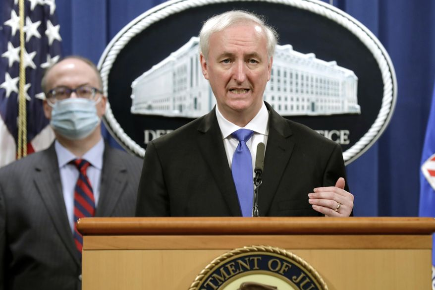 Then-Deputy Attorney General Jeffrey A. Rosen holds a news conference to announce the results of the global resolution of criminal and civil investigations with an opioid manufacturer at the Justice Department in Washington, Wednesday, Oct. 21, 2020. (Yuri Gripas/Pool via AP) ** FILE **