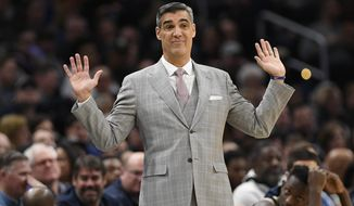 "FILE - In this March 7, 2020, file photo, Villanova head coach Jay Wright gestures during the second half of an NCAA college basketball game against Georgetown in Washington. Two-time Villanova national champion coach Jay Wright says it's ""50-50"" the sport -- which took one of the first major hits in the coronavirus pandemic era with the cancellation of the 2020 NCAA Tournament - can make it through this season intact.  (AP Photo/Nick Wass, File)"