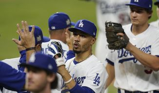 Los Angeles Dodgers right fielder Mookie Betts celebrates their win against the Tampa Bay Rays in Game 1 of the baseball World Series Tuesday, Oct. 20, 2020, in Arlington, Texas. The Dodgers defeated the Rays 8-3 to lead the series 1-0 games. (AP Photo/Eric Gay)  **FILE**
