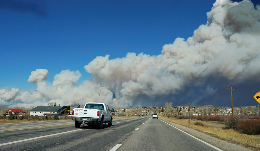 Hundreds of people in Colorado have been forced to evacuate as a wildfire intensifies. Extremely dry conditions, low humidity and winds are contributing factors in the spread of the fires in the state, a fire official said. (ASSOCIATED PRESS PHOTOGRAPHS)