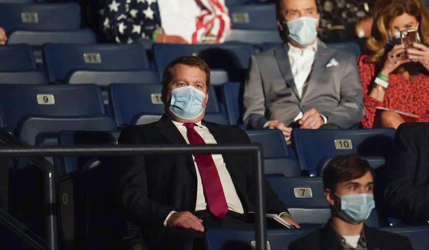 Tony Bobulinski, center seated, who says he is a former associate of Hunter Biden, waits for the start of the second and final presidential debate Thursday, Oct. 22, 2020, at Belmont University in Nashville, Tenn. (AP Photo/Julio Cortez)