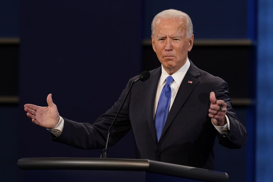 Democratic presidential candidate former Vice President Joe Biden gestures while speaking during the second and final presidential debate Thursday, Oct. 22, 2020, at Belmont University in Nashville, Tenn. (AP Photo/Patrick Semansky)