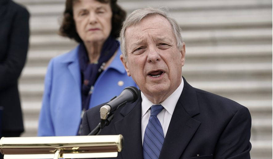 Sen. Dick Durbin, D-Ill., speaks during a news conference after boycotting the vote by the Republican-led panel to advance the nomination of Judge Amy Coney Barrett to sit on the Supreme Court, Thursday, Oct. 22, 2020, at the Capitol in Washington, as Senate Judiciary Committee ranking member Sen. Dianne Feinstein, D-Calif., and other Democratic committee members look on. (AP Photo/J. Scott Applewhite)