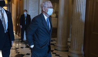 Senate Majority Leader Mitch McConnell, R-Ky., right, steps out of the Senate chamber on Capitol Hill, in Washington, Thursday, Oct. 22, 2020. (AP Photo/Jose Luis Magana)
