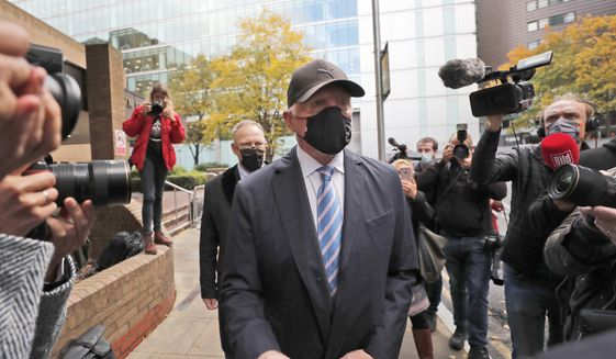 Boris Becker leaves Southwark Crown Court in London, Thursday, Oct. 22, 2020. German tennis star Boris Becker is charged with 19 offences of failing to disclose money and property as part of bankruptcy proceedings. (AP Photo/Frank Augstein)