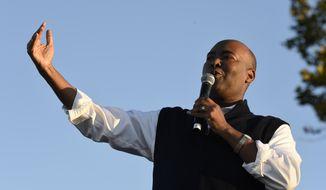 Democratic U.S. Senate candidate Jaime Harrison speaks at a campaign rally on Saturday, Oct. 17, 2020, in North Charleston, S.C. (AP Photo/Meg Kinnard)