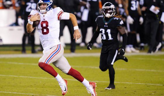 New York Giants' Daniel Jones runs with the ball during the second half of an NFL football game against the Philadelphia Eagles, Thursday, Oct. 22, 2020, in Philadelphia. (AP Photo/Chris Szagola)