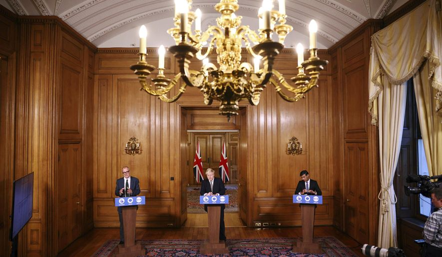 From left, Britain's Chief scientific adviser Sir Patrick Vallance, Prime Minister Boris Johnson and Chancellor of the Exchequer Rishi Sunak take part in a coronavirus briefing, in Downing Street, London, Thursday, Oct. 22, 2020. (Henry Nicholls/Pool Photo via AP)