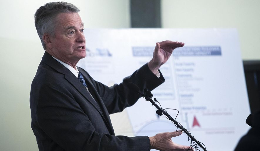FILE - In this Sept. 18, 2020 file photo Gov. Brad Little makes a COVID announcement plan during a press conference at the Joe R. Williams Building in Boise, Idaho. Moments after hearing their regional hospital was overwhelmed by COVID-19 patients and looking at sending people as far away as Seattle for care, members of Idaho's northernmost health department board voted to repeal the local mask mandate. (Darin Oswald/Idaho Statesman via AP, File)