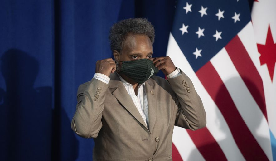 Chicago Mayor Lori Lightfoot wears her mask after speaking about Chicago Public Schools' during a press conference at City Hall in Chicago, Aug. 5, 2020. (Pat Nabong/Chicago Sun-Times via AP) ** FILE **
