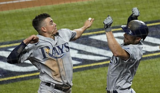 Tampa Bay Rays' Brandon Lowe, right, celebrates his a two-run home run with Willy Adames against the Los Angeles Dodgers during the fifth inning in Game 2 of the baseball World Series Wednesday, Oct. 21, 2020, in Arlington, Texas. (AP Photo/Tony Gutierrez)  **FILE**