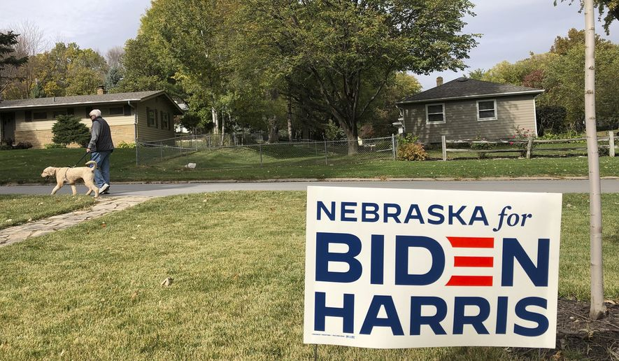 A Joe Biden presidential campaign sign greets passersby in a leafy neighborhood of Omaha, Neb., Monday, Oct. 19, 2020. If the election is close, Nebraska could play a pivotal role in deciding the winner because the state is able to divide its electoral votes, as it did when President Barack Obama won the Omaha-based 2nd Congressional District in 2008. Maine is the only other state that awards Electoral College votes by congressional district, and it could go the opposite way and award a vote to Donald Trump even as the state as a whole likely will go to Biden. (AP Photo/Grant Schulte)
