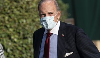 White House chief economic adviser Larry Kudlow walks back to West Wing after a television interview at the White House, Friday, Oct. 23, 2020, in Washington. (AP Photo/Alex Brandon)