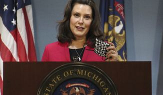 FILE - In this Thursday, May 21, 2020 file photo provided by the Michigan Office of the Governor, Michigan Gov. Gretchen Whitmer speaks during a news conference in Lansing, Mich. Gov. The Michigan Public Service Commission has some authority over Enbridge's plans to build an oil pipeline tunnel beneath the channel that connects two of the Great Lakes, a state administrative law judge ruled Friday, Oct. 23, 2020. Democratic Gov. Gretchen Whitmer has joined environmentalists and native tribes in calling for shutdown of the 67-year-old line, saying the underwater segment is vulnerable to a catastrophic rupture. (Michigan Office of the Governor via AP, Pool, File)