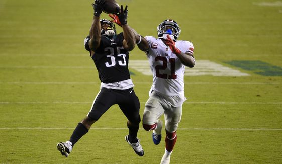 Philadelphia Eagles' Boston Scott, left, catches a touchdown pass against New York Giants' Jabrill Peppers during the second half of an NFL football game, Thursday, Oct. 22, 2020, in Philadelphia. (AP Photo/Derik Hamilton)