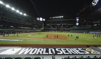 CORRECTS DATE TO MONDAY, OCT. 19, 2020 - The Tampa Bay Rays practice at Globe Life Field as the team prepares for the baseball World Series against the Los Angeles Dodgers, in Arlington, Texas, Monday, Oct. 19, 2020. (AP Photo/Eric Gay)