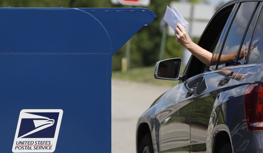 In this Aug. 19, 2020, photo, a person deposits mail in a box outside United States Post Office in Cranberry Township, Pa. U.S. Postal Service records show delivery delays have persisted across the country as millions of Americans began voting by mail, raising the possibility of ballots being rejected because they arrive too late. Parts of the politically coveted battleground states of Wisconsin, Michigan, Pennsylvania and Ohio fell short of delivery goals by wide margins as the agency struggles to regain its footing after a tumultuous summer. (AP Photo/Gene J. Puskar) **FILE**