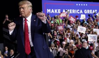 President Donald Trump dances after a campaign rally at Pensacola International Airport, Friday, Oct. 23, 2020, in Pensacola, Fla. (AP Photo/Evan Vucci)