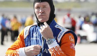 FILE  - In this Friday, July 17, 2020, file photo, Scott Dixon gets ready for qualifying for an IndyCar Series auto race at Iowa Speedway in Newton, Iowa. Chip Ganassi knew Scott Dixon as a quiet kid in a paddock full of superstars when he hired him four races into the 2002 season. The pairing has since produced the most celebrated driver of his generation. (AP Photo/Charlie Neibergall, File)
