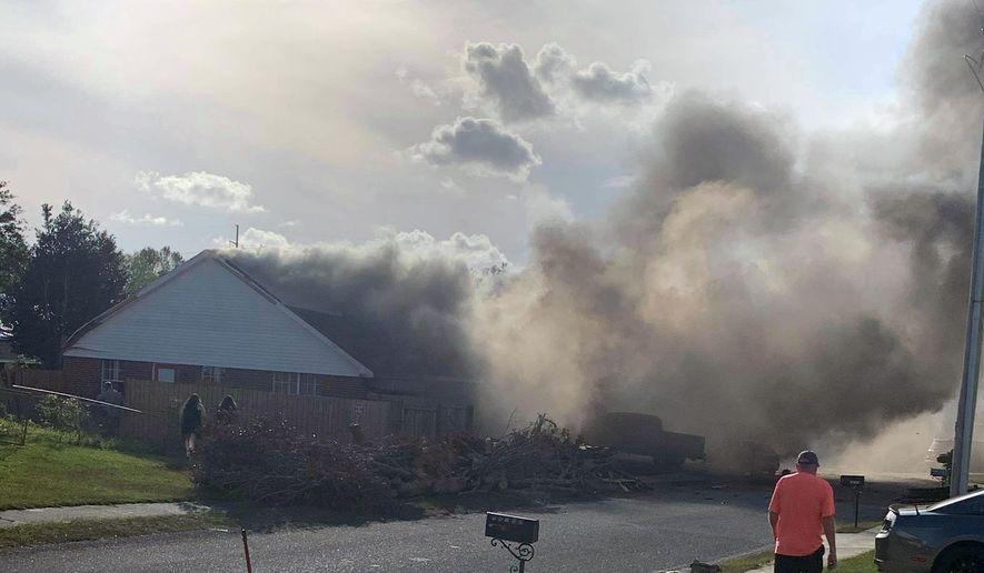 This photo provided by Greg Crippen shows the scene where a U.S. Navy training plane crashed in an Alabama residential neighborhood near the Gulf Coast, Friday, Oct. 23, 2020 near Foley, Ala. (Greg Crippen via AP)