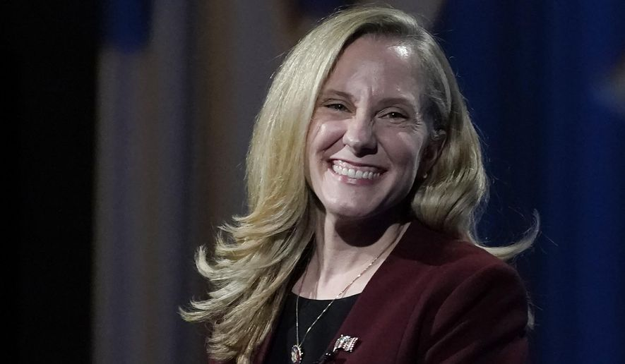 U.S. Rep. Abigail Spanberger, D-Va., smiles during a Chamber RVA sponsored candidate forum with Republican challenger Del. Nick Freitas, R-Culpeper, in Richmond, Va., Tuesday Oct. 20, 2020. Spanberger was among the historic wave of women who helped Democrats retake the U.S. House in 2018, boasting former careers with the U.S. Navy and the CIA. (AP Photo/Steve Helber)