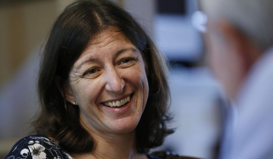 File This Thursday Oct. 3, 2019 file photo shows US Congresswoman Elaine Luria, D-2nd Va., in her home in Norfolk, Va. Luria s among the historic wave of women who helped Democrats retake the U.S. House in 2018, boasting former careers with the U.S. Navy and the CIA. (AP Photo/Steve Helber)