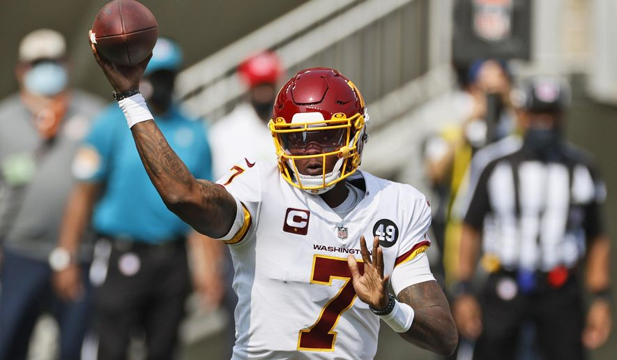 FILE - In this Sept. 27, 2020, file photo, Washington Football Team quarterback Dwayne Haskins throws during the first half of an NFL football game against the Cleveland Browns in Cleveland. Haskins has been fined by the team for breaking COVID-19 protocols, a person with knowledge of the decision tells The Associated Press. ESPN reported Haskins was fined $4,833 for making a reservation for a family friend at the team hotel last weekend when Washington visited the New York Giants. (AP Photo/Ron Schwane, File)