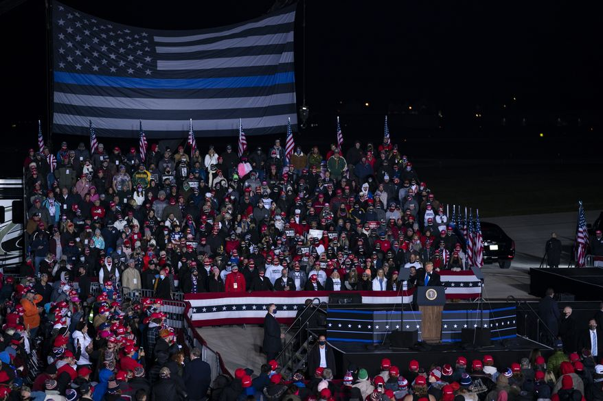 President Donald Trump speaks during a campaign rally at Waukesha County Airport, Saturday, Oct. 24, 2020, in Waukesha, Wis. (AP Photo/Evan Vucci)