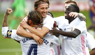 Real Madrid's Luka Modric celebrates scoring his side's 3rd goal during the Spanish La Liga soccer match between FC Barcelona and Real Madrid at the Camp Nou stadium in Barcelona, Spain, Saturday, Oct. 24, 2020. (AP Photo/Joan Monfort)
