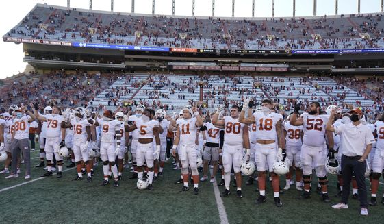 """Texas players, including Sam Ehlinger (11), sing """"The Eyes Of Texas"""" after an NCAA college football game against Baylor in Austin, Texas, Saturday, Oct. 24, 2020. (AP Photo/Chuck Burton)  **FILE**"""