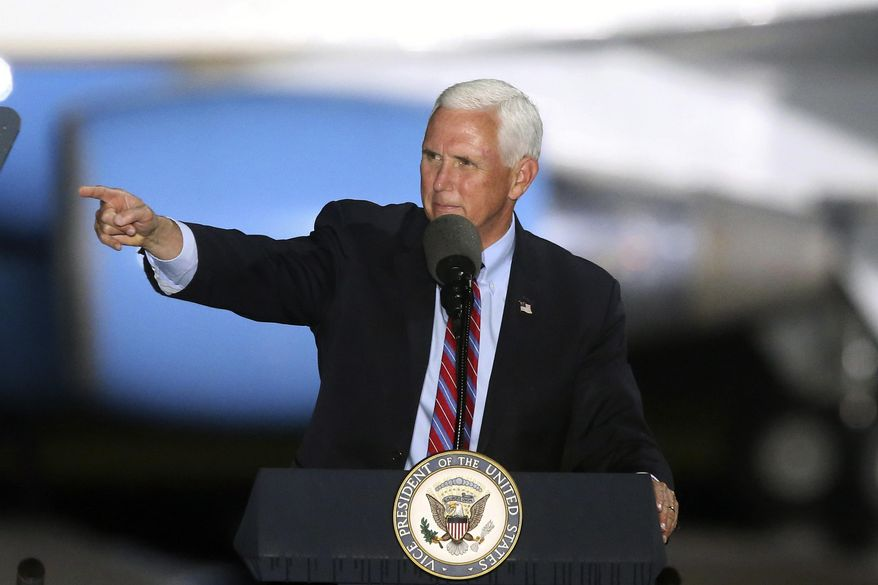 Vice President Mike Pence speaks to supporters Saturday Oct. 24, 2020 in Tallahassee, Fla. Battleground Florida was again a central focus of the presidential campaign Saturday as President Donald Trump, Vice President Mike Pence and former President Barack Obama all had high-profile events in the state. (AP Photo/Steve Cannon)