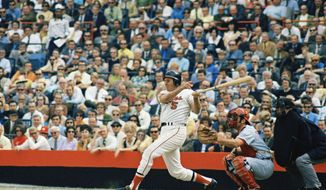 FILE - Baltimore Orioles third baseman Brooks Robinson takes a swing during a 1970 game at Memorial Stadium in Baltimore. Fifty years later, Robinson still recalls details from the 1970 World Series. (AP Photo/File)