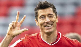 Bayern's Robert Lewandowski celebrates after scoring his side's third goal of the game during the German Bundesliga soccer match between Bayern Munich and Frankfurt, in the Allianz Arena, Munich, Germany, Saturday, Oct. 24, 2020. (Matthias Balk/dpa via AP)