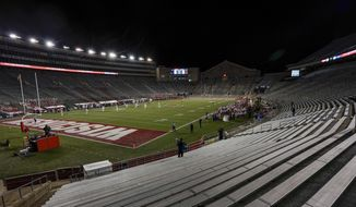 The stands at Camp Randall Stadium are empty during the first half of an NCAA college football game between Wisconsin and Illinois Friday, Oct. 23, 2020, in Madison, Wis. (AP Photo/Morry Gash)  **FILE**